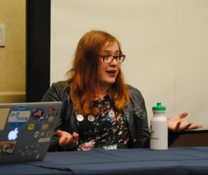 Photo of Shayna talking on a panel